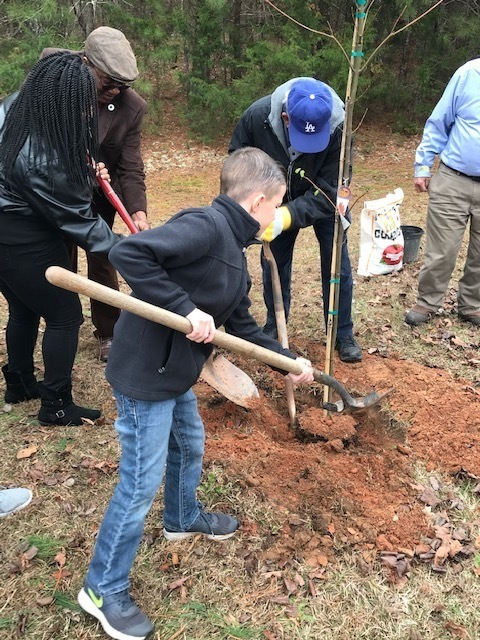Student digging hole for Arbor Day lesson