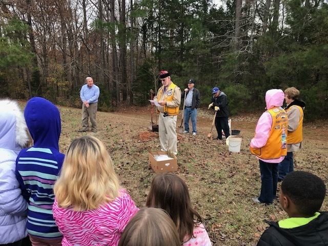 Lions Club members teaching about Arbor Day