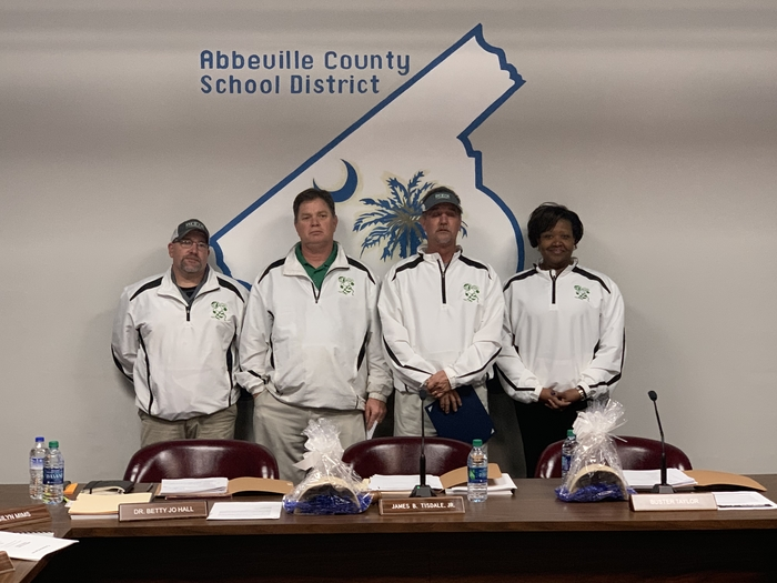 Dixie High football coaches and principal, Lori Brewton