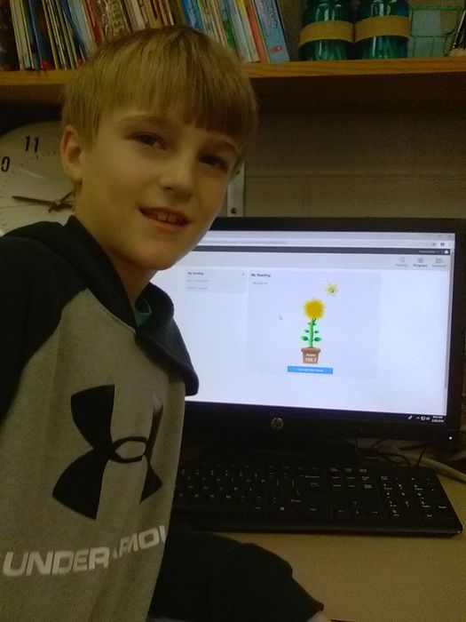 Thomas Moore is shown as his Accelerated Reader Screen displays his 100 point achievement