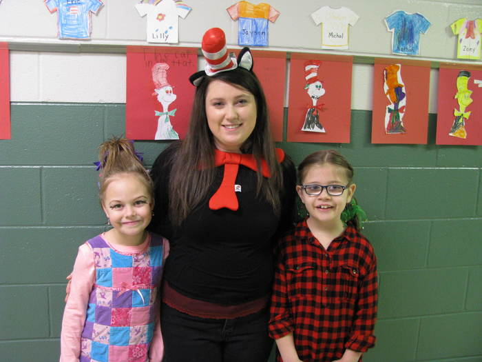Mrs. Austin with two of her students dressed up for Seuss Yourself