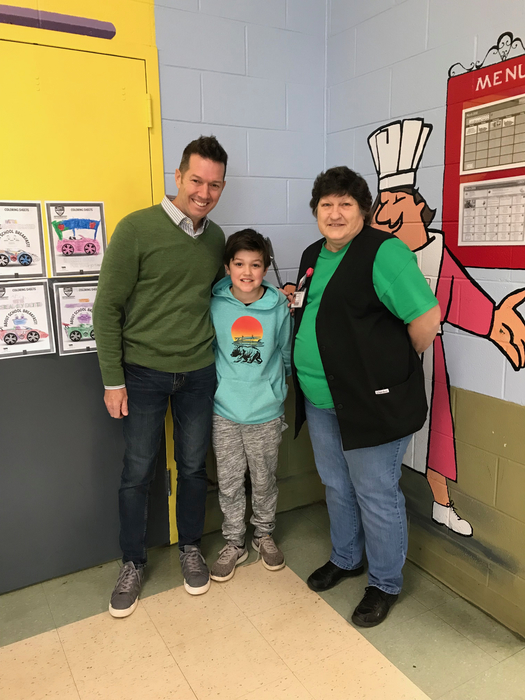 Brennan Louk with CTES principal and lunch staff
