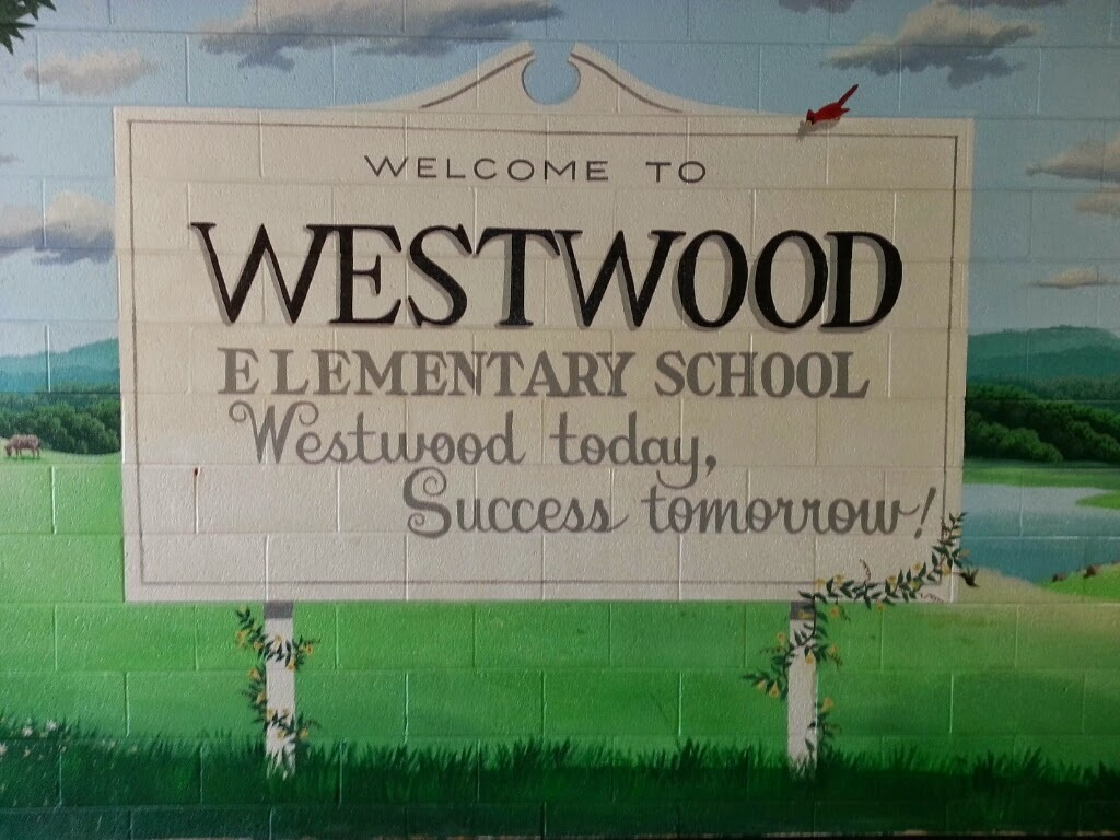 "Mural painted on wall stating, ""Welcome to Westwood Elementary School. Westwood today, Success tomorrow!"""
