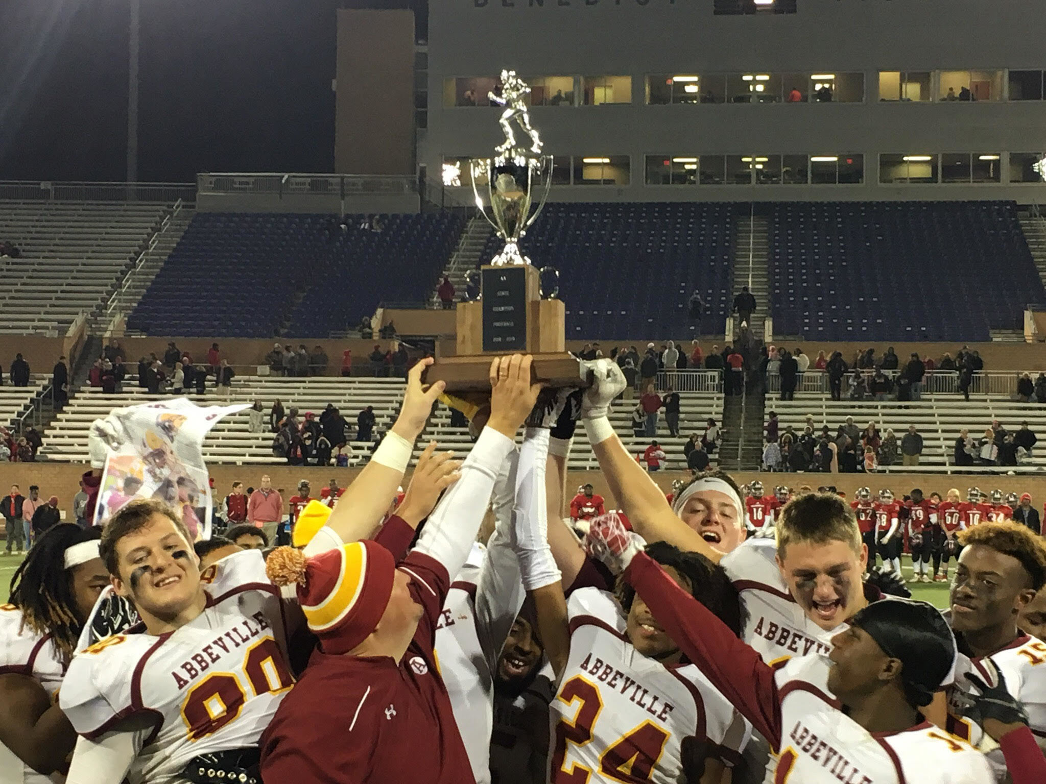 Football team holding trophy